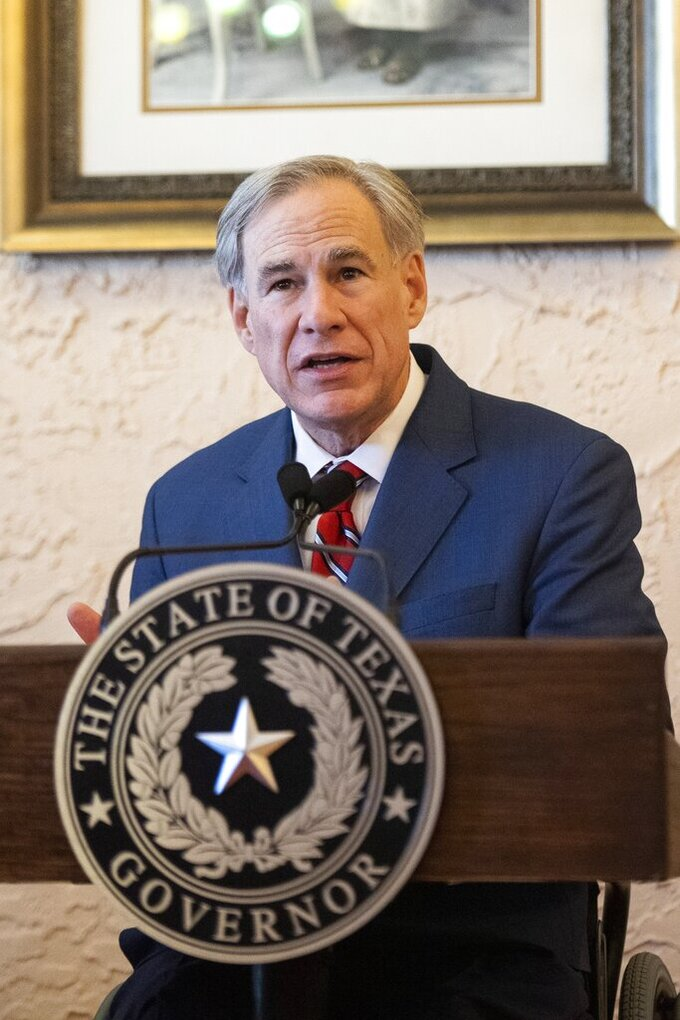 Texas Governor Greg Abbott delivers an announcement in Montelongo's Mexican Restaurant on Tuesday, March 2, 2021, in Lubbock, Texas. Abbott announced that he is rescinding executive orders that limit capacities for businesses and the state wide mask mandate. (AP Photo/Justin Rex)