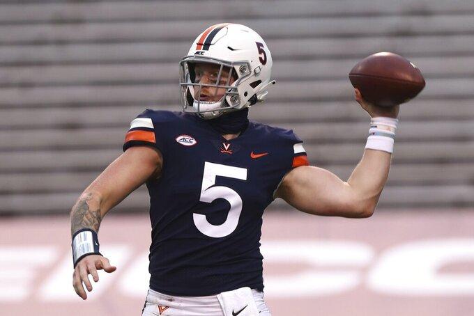 Virginia quarterback Brennan Armstrong (5) throws the ball during an NCAA college football game against Duke, Saturday, Sept. 26, 2020, in Charlottesville, Va. (Erin Edgerton/The Daily Progress via AP)