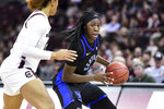 Kentucky guard Rhyne Howard (10) dribbles the ball against South Carolina guard Breanna Beal during the second half of an NCAA college basketball game Thursday, Jan. 2, 2020, in Columbia, S.C. South Carolina defeated Kentucky 99-72. (AP Photo/Sean Rayford)