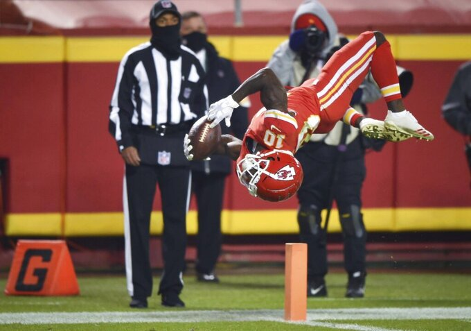 Kansas City Chiefs wide receiver Tyreek Hill (10) does a back flip in the second half of an NFL game against the Denver Broncos on Sunday, Dec. 6, 2020, at Arrowhead Stadium in Kansas City. Hill ran for 48-yard scoring play which was was then called back on a holding penalty. The Chiefs defeated the Broncos, 22-16.  (Tammy Ljungblad/The Kansas City Star via AP)
