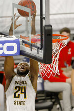 Wichita State forward Morris Udeze (24) goes up for a pass above the rim against Cincinnati during the first half of an NCAA college basketball game in the semifinal round of the American Athletic Conference men's tournament Saturday, March 13, 2021, in Fort Worth, Texas. (AP Photo/Ron Jenkins)