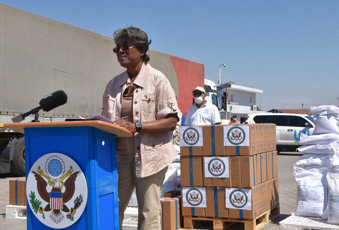 In this handout photo provided by the US Embassy in Turkey, Linda Thomas-Greenfield, U.S. Ambassador to the United Nations, speaks at the Bab al-Hawa border crossing between Turkey and Syria, Thursday, June 3, 2021. Thomas-Greenfield announced on Thursday nearly $240 million in humanitarian funding to support the people of Syria, Syrian refugees and countries hosting them, and called for access through international crossings to allow the delivery of aid. Linda Thomas-Greenfield made the announcement during a visit to the Bab al-Hawa border crossing between Turkey and Syria — the sole remaining point of access for humanitarian aid to enter the conflict-ravaged country. (US Embassy in Turkey via AP)