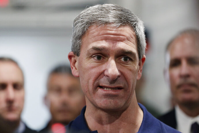 Acting director of U.S. Citizenship and Immigration Services Ken Cuccinelli talks during a walk through of the Migration Protection Protocols Immigration Hearing Facility, Tuesday, Sept. 17, 2019, in Laredo, Texas. Cuccinelli is emerging as the public face of the president's hard-line immigration policies. (AP Photo/Eric Gay)