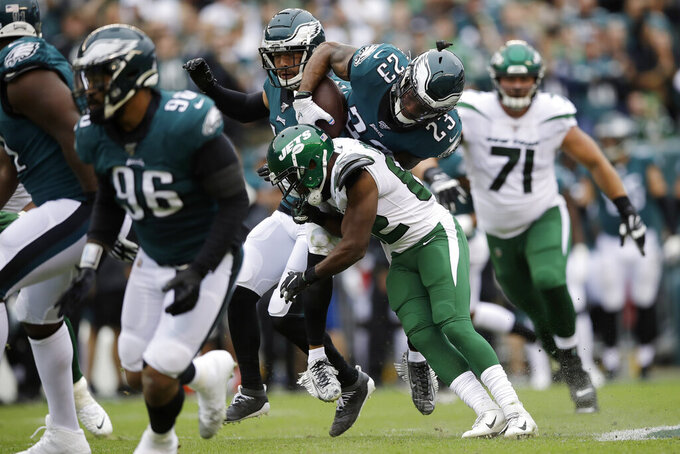 Philadelphia Eagles' Rodney McLeod (23) is tackled by New York Jets' Jamison Crowder (82) after interception a pass during the first half of an NFL football game, Sunday, Oct. 6, 2019, in Philadelphia. (AP Photo/Matt Rourke)