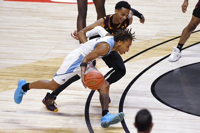 Rhode Island's Fatts Russell drives past Arizona State's Alonzo Verge Jr. during the second half of an NCAA college basketball game Wednesday, Nov. 25, 2020, in Uncasville, Conn. (AP Photo/Jessica Hill)