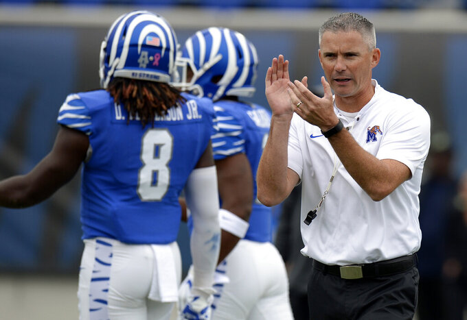 FILE - In this Oct. 13, 2018, file photo, Memphis head coach Mike Norvell watches his players warm up before an NCAA college football game against Central Florida in Memphis, Tenn. The rivalry between Mississippi and Memphis dates back almost 100 years, often an early-season test with the Rebels piling up plenty of victories. These teams meet Saturday in the season opener for what could be the last game between them, and for a change, Memphis is favored. (AP Photo/Mark Zaleski, File)