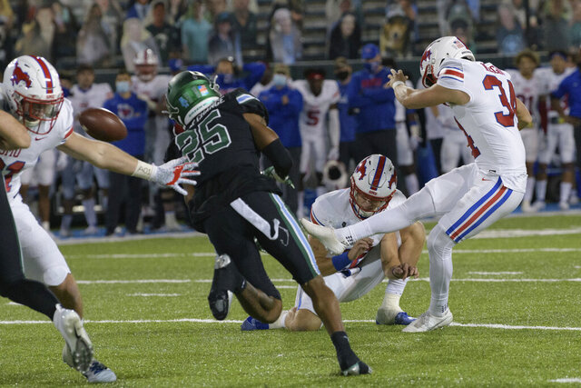SMU placekicker Chris Naggar (34) kicks the winning field goal in overtime to give his team a victory over Tulane in an NCAA college football game in New Orleans, Friday, Oct. 16, 2020. (AP Photo/Matthew Hinton)
