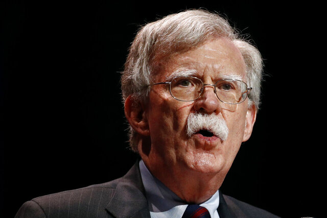 FILE - In this July 8, 2019, file photo, national security adviser John Bolton speaks at the Christians United for Israel's annual summit, in Washington.  A single paper copy in a nondescript envelope arrived at the White House on Dec. 30. Four weeks later, news of John Bolton's book manuscript about his time as President Donald Trump's national security adviser has exploded into public view, sending a jolt through the president's impeachment trial. (AP Photo/Patrick Semansky, File)