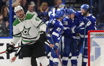 Dallas Stars' Roman Polak, of Czech Republic, skates away as Tampa Bay Lightning players celebrate a goal during the first period of an NHL hockey game Thursday, Feb. 14, 2019, in Tampa, Fla. (AP Photo/Mike Carlson)