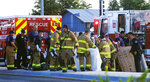 Albuquerque Fire Rescue crews work on victims of the fatal balloon crash at Unser and Central SW in Albuquerque, N.M., on Saturday, June 26, 2021. Multiple people were killed in the crash. (Adolphe Pierre-Louis/The Albuquerque Journal via AP)