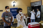 A health worker prepares a shot of the AstraZeneca vaccine for COVID-19 during a vaccination campaign for people over age 35 in Rio de Janeiro, Brazil, Friday, July 23, 2021. (AP Photo/Bruna Prado)