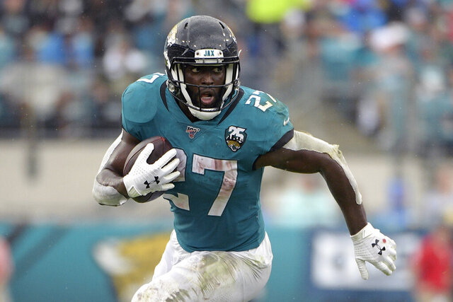 FILE - In this Oct. 27, 2019, file photo, Jacksonville Jaguars running back Leonard Fournette (27) rushes for yardage against the New York Jets during the first half of an NFL football game, in Jacksonville, Fla. Fournette used to be considered a building block in Jacksonville. Then he ended up on the trading block. Now, the bruising running back is entering the final year of his rookie contract and facing an uncertain future with the franchise. (AP Photo/Phelan M. Ebenhack, File)