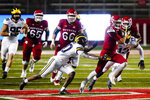 Rutgers' Noah Vedral (0) rushes past Michigan's Brad Hawkins, left, and Josh Ross, right, during the first half of an NCAA college football game Saturday, Nov. 21, 2020, in Piscataway, N.J. (AP Photo/Frank Franklin II)
