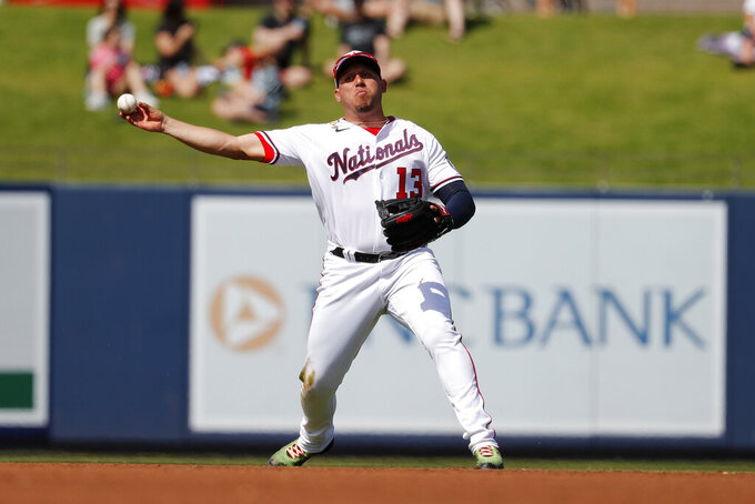 File-This March 2, 2020, file photo shows Washington Nationals third baseman Asdrubal Cabrera throws to first during the fourth inning of a spring training baseball game against the Miami Marlins in West Palm Beach, Fla. The Arizona Diamondbacks have agreed to terms on a $1.75 million, one-year deal with veteran infielder Cabrera, according to a person with knowledge of the negotiations. The agreement was reached on Friday, Feb. 12, 2021, and confirmed by The Associated Press on condition of anonymity because the deal is pending the completion of a successful physical exam. (AP Photo/Jeff Roberson, File)