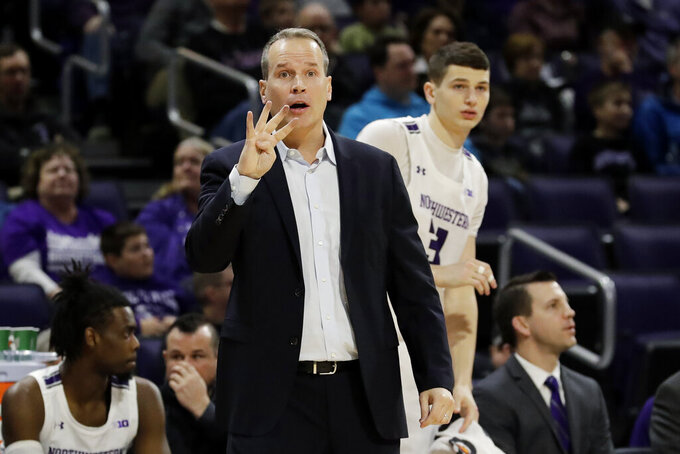 Northwestern head coach Chris Collins signals during the first half of an NCAA college basketball game against Minnesota in Evanston, Ill., Sunday, Feb. 23, 2020. (AP Photo/Nam Y. Huh)