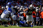 Auburn quarterback Bo Nix (10) is tacked by Georgia State defensive end Javon Denis (98) as he scrambles during the first half of an NCAA college football game Saturday, Sept. 25, 2021, in Auburn, Ala. (AP Photo/Butch Dill)