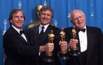 FILE - In this Sunday, March 25, 2001 file photo, from left: Douglas Wick, David Franzoni and Branko Lustig hold their Oscars backstage at the Shrine Auditorium in Los Angeles, after