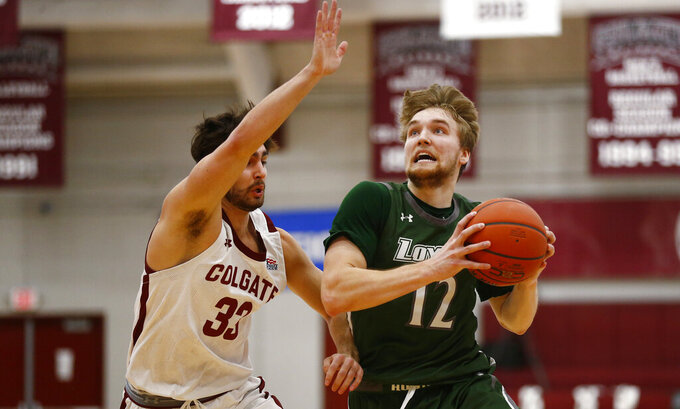 Colgate vs Loyola (Md.) Cam Spencer (12) drives past Colgate's Oliver Lynch-Daniels (33) during an NCAA college basketball game in the finals of the Patriot League tournament, Sunday, March 14, 2021, in Hamilton, N.Y. (AP Photo/John Munson)