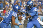Kentucky quarterback Terry Wilson (3) hands the ball off too running back Benny Snell Jr. (26) during the first half of an NCAA college football game against Middle Tennessee in Lexington, Ky., Saturday, Nov. 17, 2018. (AP Photo/Bryan Woolston)