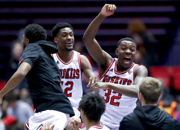 Northern Illinois' Levi Bradley (42) and Austin Richie (32) celebrate with teammates after Northern Illinois defeated Buffalo 77-75 in an NCAA college basketball game Tuesday, Jan. 22, 2019, in DeKalb, Ill. (AP Photo/Nam Y. Huh)