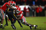 Missouri running back Tyler Badie (1) is taken down by Georgia linebacker Nakobe Dean (17) and Georgia inside linebacker Tae Crowder (30) in the first half of a NCAA football game between Georgia and Missouri in Athens, Ga., on Saturday, Nov. 9, 2019. (Joshua L. Jones/Athens Banner-Herald via AP)