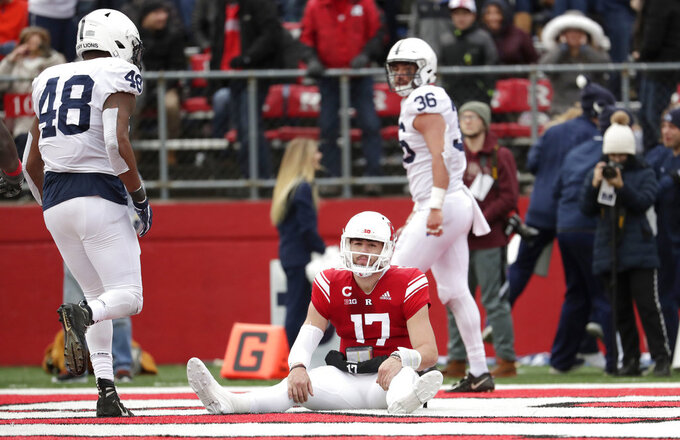 Rutgers quarterback Giovanni Rescigno (17) sits on the end zone after dropping a pass on a fourth down play against Penn State during the second half of an NCAA college football game, Saturday, Nov. 17, 2018, in Piscataway, N.J. (AP Photo/Julio Cortez)