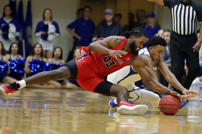 Stony Brook guard Andrew Garcia (23) and Seton Hall guard Jared Rhoden dive for a loose ball during the second half of an NCAA college basketball game Saturday, Nov. 9, 2019, in South Orange, N.J. Seton Hall won 74-57. (AP Photo/Adam Hunger)