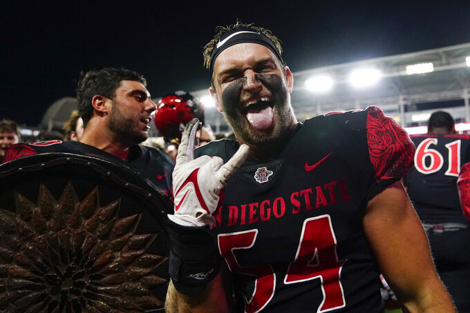 San Diego State linebacker Caden McDonald (54) celebrates after a 33-31 win in triple overtime against Utah in an NCAA college football game Saturday, Sept. 18, 2021, in Carson, Calif. (AP Photo/Ashley Landis)