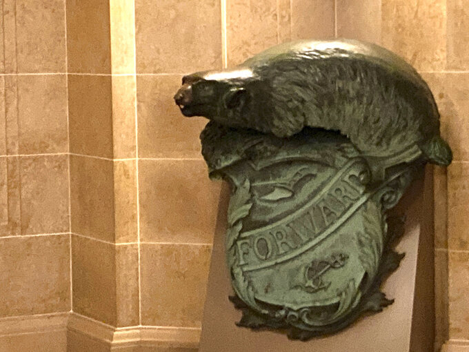 FILE - In this Jan. 27, 2021 file photo, a Badger and Shield statue is seen outside the governor's Capitol office in Madison, Wis., Wednesday, Jan. 27, 2021. On loan for more than 30 years, the U.S. Naval Academy wants the state of Wisconsin to return the statue. The Navy wants to include it in an exhibit featuring the USS Wisconsin battleship in Norfolk, Va. State historians are fighting to keep the statue in the state for another two years. The Navy has paused plans to move a beloved badger statue from Wisconsin to the East Coast for at least two years. (AP Photo/Todd Richmond File)