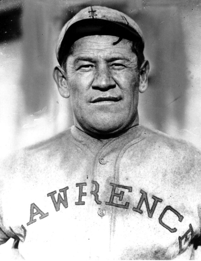 FILE - In this is undated file photo,  Jim Thorpe poses in a baseball uniform. Thorpe was on top of the world after winning gold medals in the decathlon and pentathlon at the 1912 Stockholm Olympics with mind-blowing performances that went unmatched for decades. They so impressed the King of Sweden that he told Thorpe he was