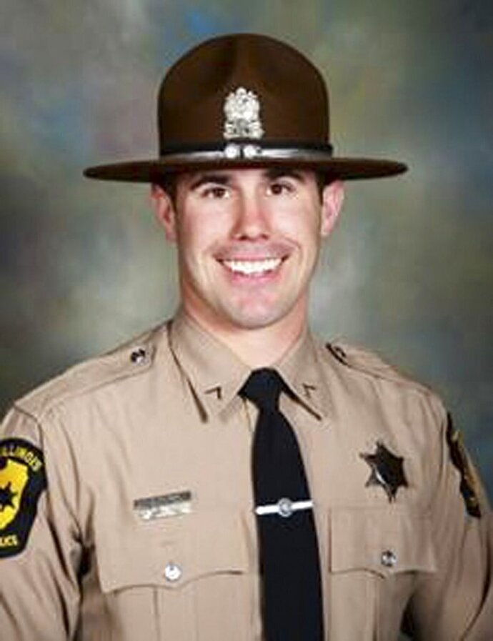 This photo provided by the Illinois State Police shows Illinois State Trooper Nicholas Hopkins. Hopkins an Illinois State Police trooper died from wounds suffered early Friday, Aug. 23, 2019 while executing a search warrant in East St. Louis. (Illinois State Police via AP)