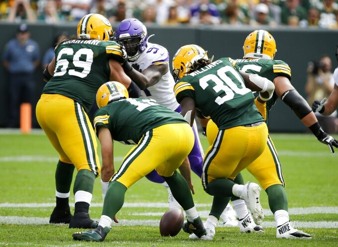 Green Bay Packers' Aaron Rodgers fumbles during the second half of an NFL football game against the Minnesota Vikings Sunday, Sept. 15, 2019, in Green Bay, Wis. The Vikings recovered the fumble. (AP Photo/Mike Roemer)
