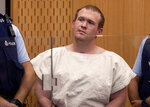 FILE - In this March 16, 2019, file photo, Brenton Harrison Tarrant, the man charged in the Christchurch mosque shootings, appears in the Christchurch District Court, in Christchurch, New Zealand. More than 60 survivors and family members will confront the New Zealand mosque gunman during the four-day sentencing starting Monday, Aug. 24, 2020. Twenty-nine-year-old Australian Tarrant has pleaded guilty to 51 counts of murder, 40 counts of attempted murder and one count of terrorism in the worst atrocity in the nation's modern history.(Mark Mitchell/Pool Photo via AP, File)