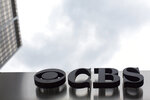 FILE - This May 10, 2017, file photo, shows the CBS logo at their broadcast center in New York. CBS has resisted pressure from its controlling shareholder, National Amusements, to merge with Viacom, which also is controlled by National Amusements. The two companies used to be one but separated in 2005. (AP Photo/Mary Altaffer, File)