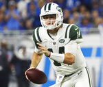FILE - In this Sept. 10, 2018, file photo, New York Jets quarterback Sam Darnold (14) scrambles against the Detroit Lions during an NFL football game, in Detroit. The Jets rookie quarterback will take on the Indianapolis Colts on Sunday. (AP Photo/Rick Osentoski, File)