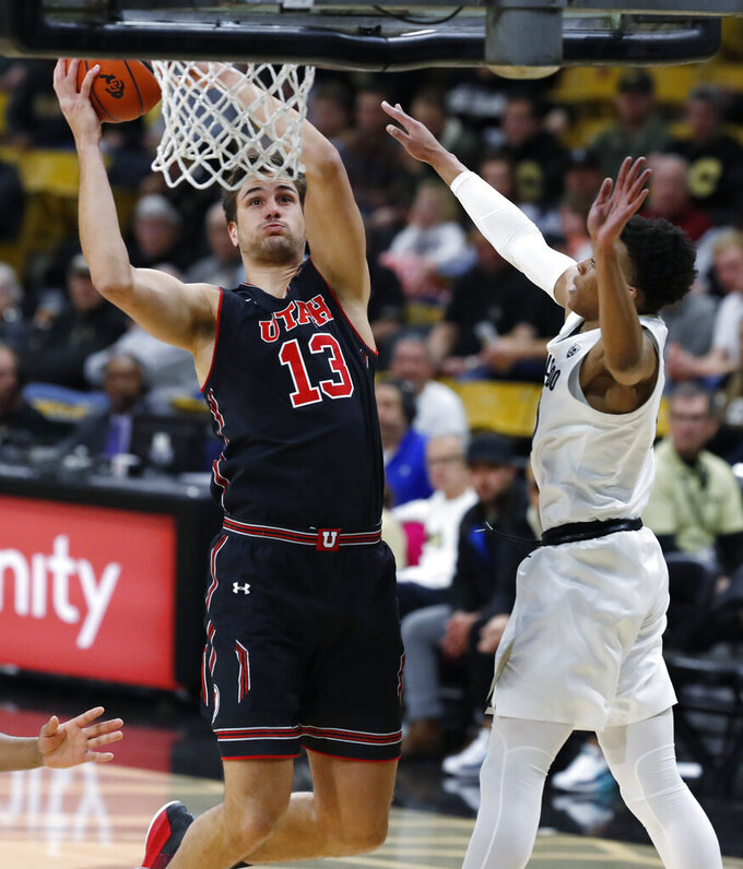 Utah forward Novak Topalovic, left, goes up for a basket as Colorado guard Shane Gatling defends in the first half of an NCAA college basketball game Saturday, March 2, 2019, in Boulder, Colo. (AP Photo/David Zalubowski)