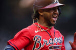 Atlanta Braves' Ozzie Albies runs after hitting a single during the first inning of the team's baseball game against the Los Angeles Dodgers on Friday, June 4, 2021, in Atlanta. (AP Photo/Brynn Anderson)