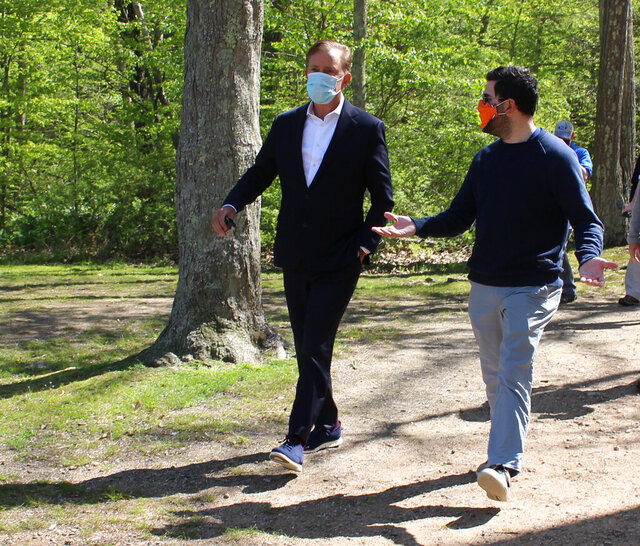 FILE - In this May 21, 2020, file photo, Connecticut Gov. Ned Lamont, left, talks to his communications director, Max Reiss, as they head to a news conference at Gay City State Park in Hebron, Conn. On Friday, Nov. 13, 2020, Reiss identified himself as the senior staff member who had tested positive for COVID-19 in a release posted to Twitter. (AP Photo/Pat Eaton-Robb, File)