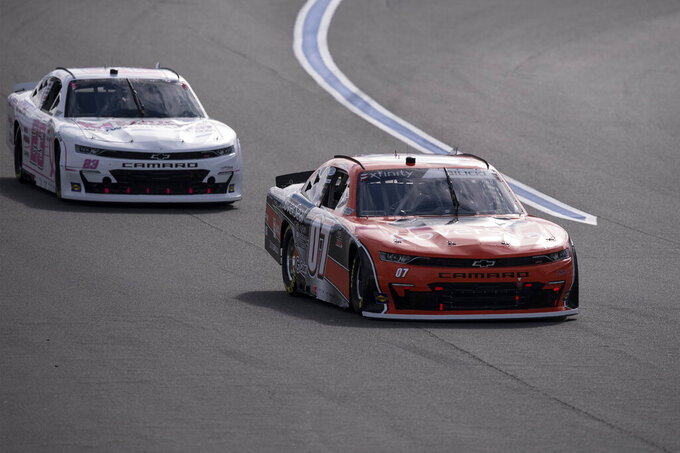 NASCAR Xfinity Series driver Josh Bilicki (07) and Ty Dillon (23) race during the NASCAR Xfinity auto racing race at the Charlotte Motor Speedway Saturday, Oct. 9, 2021, in Concord, N.C. (AP Photo/Matt Kelley)