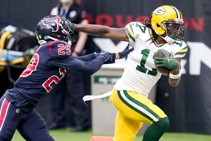Green Bay Packers wide receiver Davante Adams (17) runs with the ball as Houston Texans cornerback Phillip Gaines (29) defends during the first half of an NFL football game Sunday, Oct. 25, 2020, in Houston. (AP Photo/Sam Craft)
