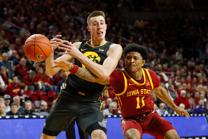 Iowa guard Joe Wieskamp drives to the basket past Iowa State guard Prentiss Nixon, right, during the second half of an NCAA college basketball game, Thursday, Dec. 12, 2019, in Ames, Iowa. (AP Photo/Charlie Neibergall)