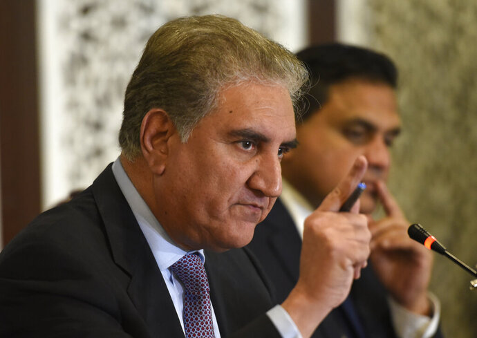 Pakistani Foreign Minister Shah Mahmood Qureshi addresses a news conference in Islamabad, Pakistan, Thursday, Aug. 8, 2019. Qureshi said Thursday that Islamabad is not considering any military actions and instead is looking at political and legal options to challenge India's changes to disputed Kashmir's status. Qureshi rejected New Delhi's claim that the changes were its internal matter and that Islamabad should reconsider its expulsion of India's ambassador and suspension of trade and a key train service. (AP Photo/B.K. Bangash)