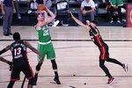 Miami Heat's Bam Adebayo (13) and Tyler Herro, right, defend as Boston Celtics forward Gordon Hayward (20) attempts a shot during the second half of an NBA conference final playoff basketball game, Saturday, Sept. 19, 2020, in Lake Buena Vista, Fla. (AP Photo/Mark J. Terrill)