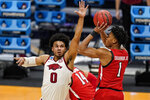 Texas Tech guard Terrence Shannon Jr. (1) shoots over Arkansas forward Justin Smith (0) in the first half of a second-round game in the NCAA men's college basketball tournament at Hinkle Fieldhouse in Indianapolis, Sunday, March 21, 2021. (AP Photo/Michael Conroy)