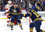 Buffalo Sabres Jeff Skinner (53) and Henri Jokiharju (10) celebrate a goal during the third period of an NHL hockey game against the Carolina Hurricanes, Thursday, Nov. 14, 2019, in Buffalo, N.Y. (AP Photo/Jeffrey T. Barnes)
