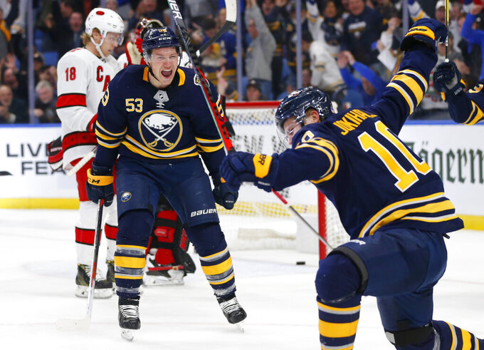 Buffalo Sabres Jeff Skinner (53) and Henri Jokiharju (10) celebrate a goal during the third period of an NHL hockey game against the Carolina Hurricanes, Thursday, Nov. 14, 2019, in Buffalo N.Y. (AP Photo/Jeffrey T. Barnes)