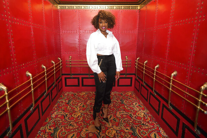 """In this Aug. 2, 2021 photo, Jennifer Hudson poses for a portrait to promote """"Respect"""" at the Fox Theatre in Detroit.  Hudson has in some ways been preparing to play Aretha Franklin for her entire life, but she was still surprised when the Queen of Soul asked her to take on the role following her Oscar win for """"Dreamgirls"""" in 2007.  The film from director Liesl Tommy follows Franklin from childhood through the 1972 recording of the gospel album """"Amazing Grace."""" It opens nationwide Friday. (AP Photo/Paul Sancya)"""