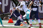 New England Patriots quarterback Cam Newton (1) scores his second rushing touchdown as Miami Dolphins linebacker Jerome Baker (55) chases in the second half of an NFL football game, Sunday, Sept. 13, 2020, in Foxborough, Mass. (AP Photo/Steven Senne)