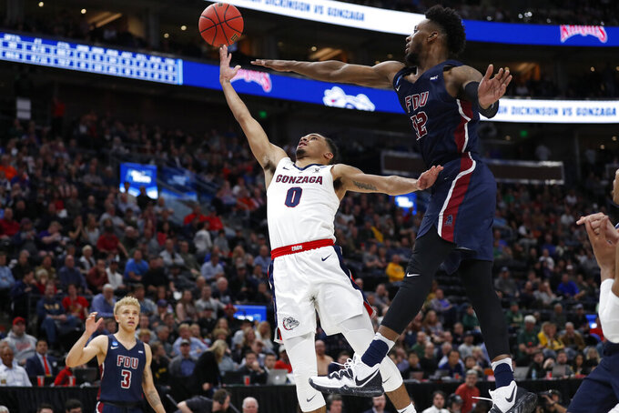 Gonzaga guard Geno Crandall (0) shoots against Fairleigh Dickinson forward Kaleb Bishop (12) during the first half of a first-round game in the NCAA men's college basketball tournament Thursday, March 21, 2019, in Salt Lake City. (AP Photo/Jeff Swinger)