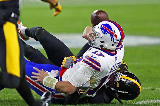 Buffalo Bills quarterback Josh Allen (17) fumbles as he is tackled by Pittsburgh Steelers strong safety Terrell Edmunds (34) during the first half of an NFL football game in Pittsburgh, Sunday, Dec. 15, 2019. (AP Photo/Keith Srakocic)